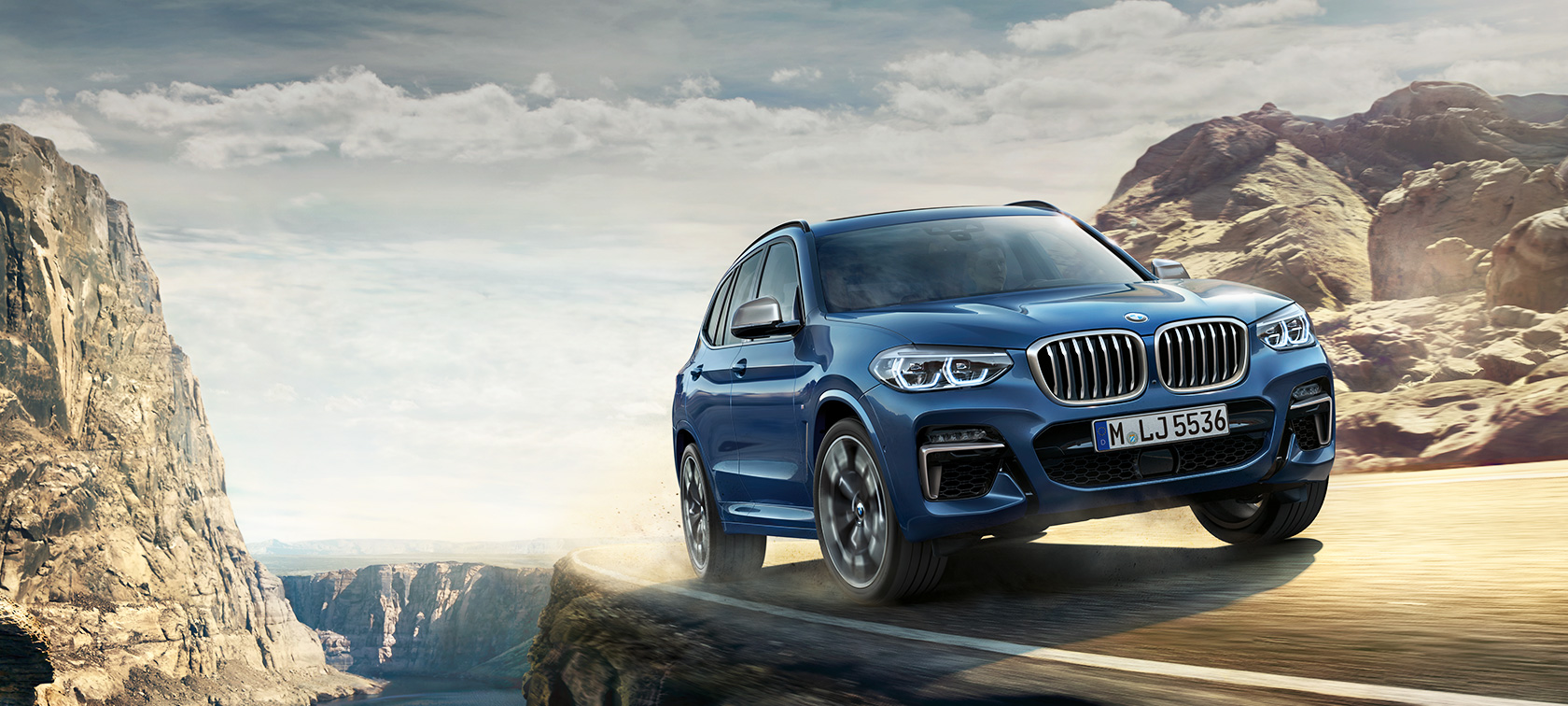 BMW X3 M40i on mountain trail, driving shot