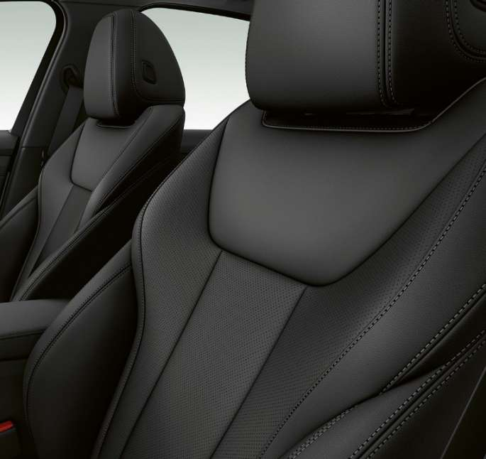 Side close-up of the front seats of the BMW 3 Series Sedan with Model Sport Line features.