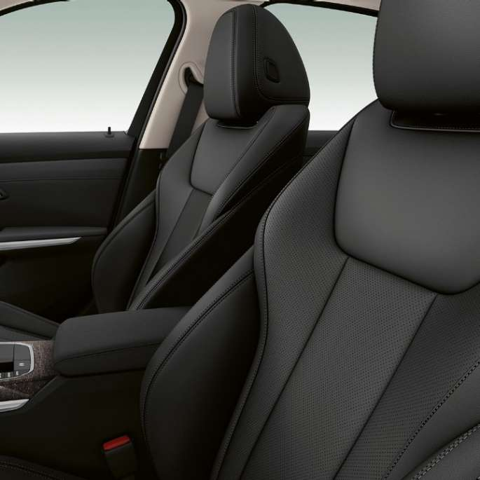 Side close-up of the front seats of the BMW 3 Series Sedan with Model Luxury Line features.